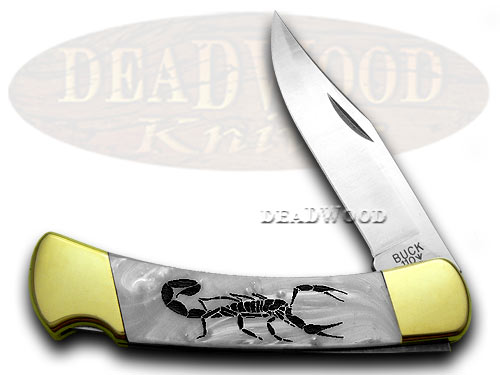 Buck 110 Custom White Pearl Corelon Scorpion 1/400 Pocket Knives