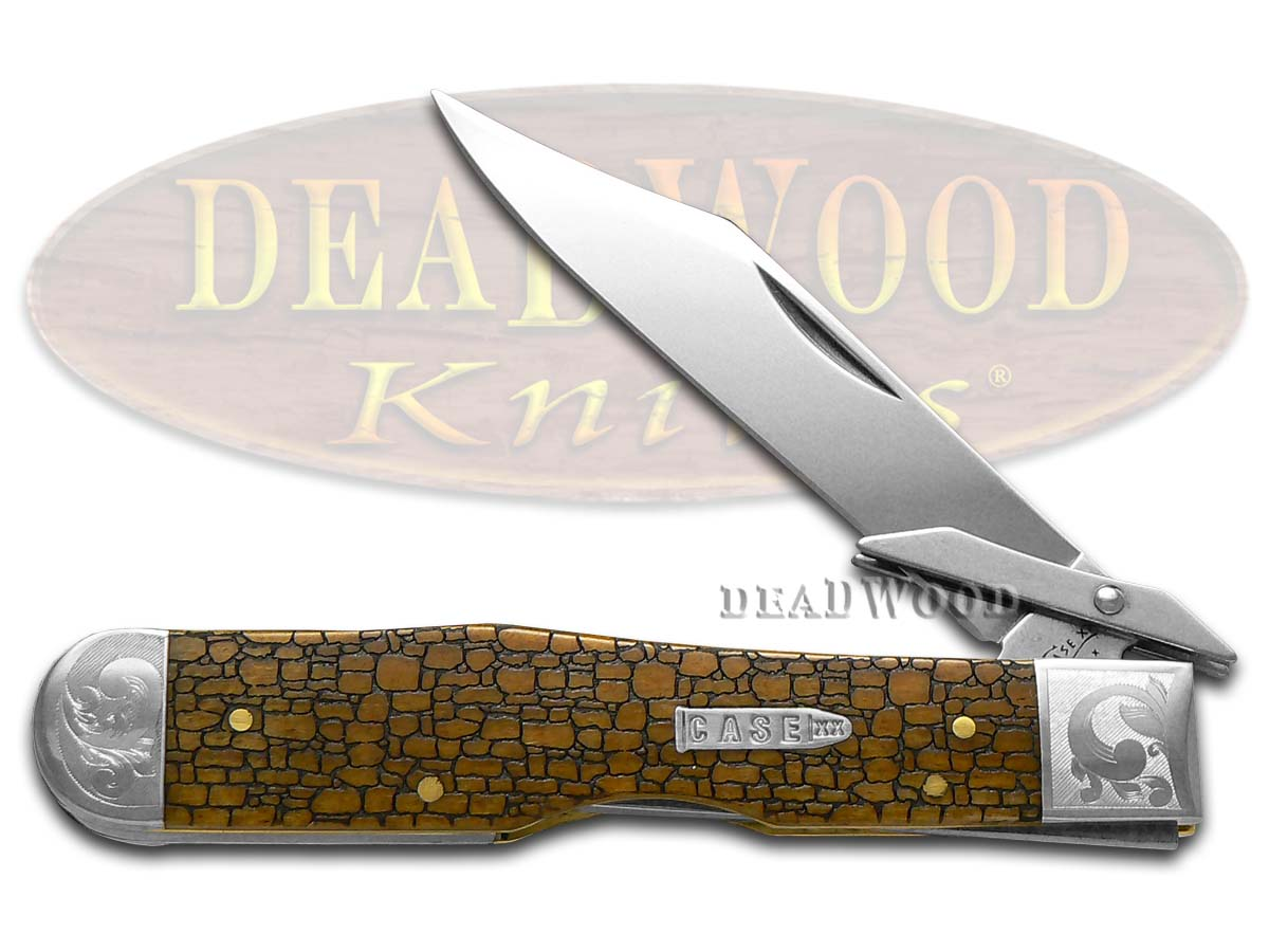 Case XX Scrolled Stone Wall Antique Bone Cheetah 1/200 Stainless Pocket Knife